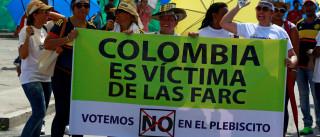 Um dia após acordo com Farc,  colombianos pensam em referendo