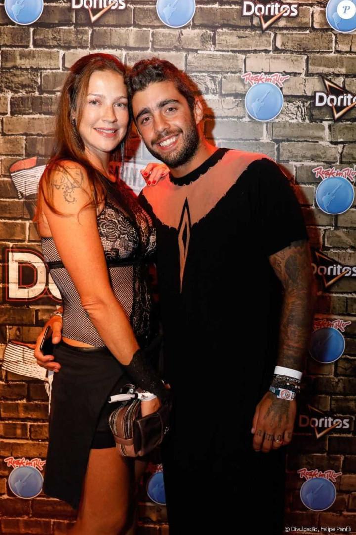 Com Luana Piovani, Pedro Scooby vai de vestido ao Rock in Rio